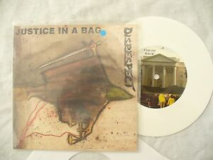 DISRESPECT-JUSTICE-IN-A-BAG-ep-with-lyric-sheet-press-release-N-M-WHITE-punk
