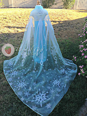 "Frozen large cape length 75"" light blue/turquoise with silver glitter snowflakes"