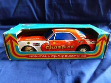 """Taiyo Japon 1970 - The racer Chevrolet Camaro """"Champion"""" en tôle lithographiée"""