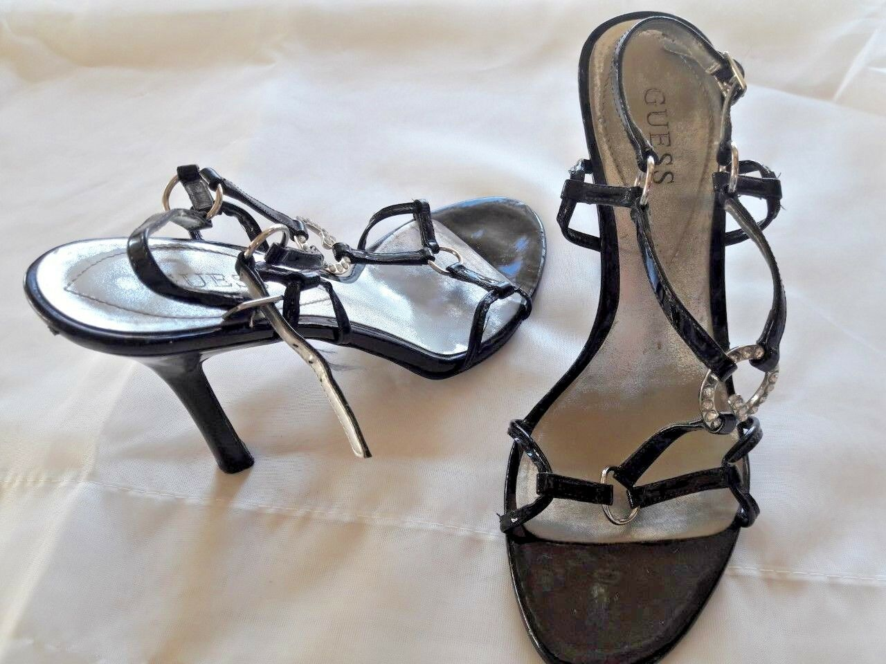 Guess high heel black sandals, heel size  6._ 4