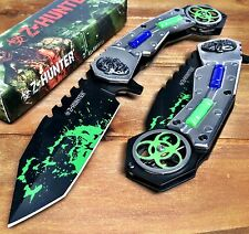 SPRING ASSISTED ZOMBIE KNIFE WITH METAL HANDLE AND BIO HAZARD LOGO -SILVER