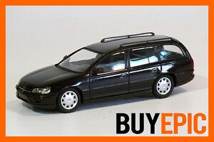 Schuco-Opel-Omega-B-Caravan-Break-1-43-bleu-mer-polaire-bleu-Maquette-de-voiture