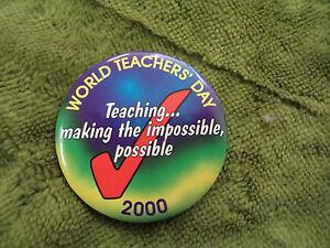 #D290. 2000   WORLD  TEACHERS'  DAY  TIN   BADGE