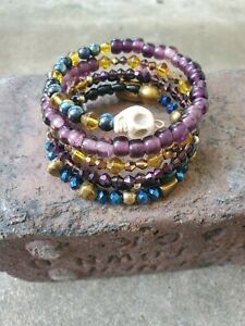 womens handmade purple, gold, blue, & black beads on memory wire with skull