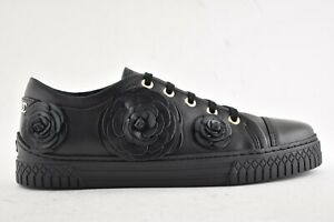 bee6ce050277c Chanel 18K Black Lambskin Leather CC Camellia Low Top Flat Trainer ...