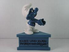A4- Schlumpf / Smurf 5.5131 Dreiecksockel Gratulationsschlumpf / smurf on stand