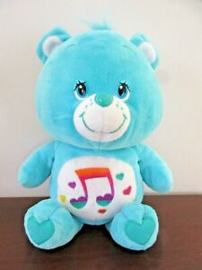 CARE-BEAR-32-cm-Aqua-with-embroidered-Music-note-on-Tummy-2007-vgu