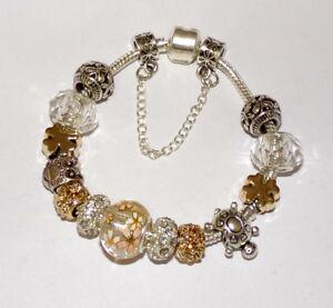 Bracelet-avec-Charms-argent-et-dores