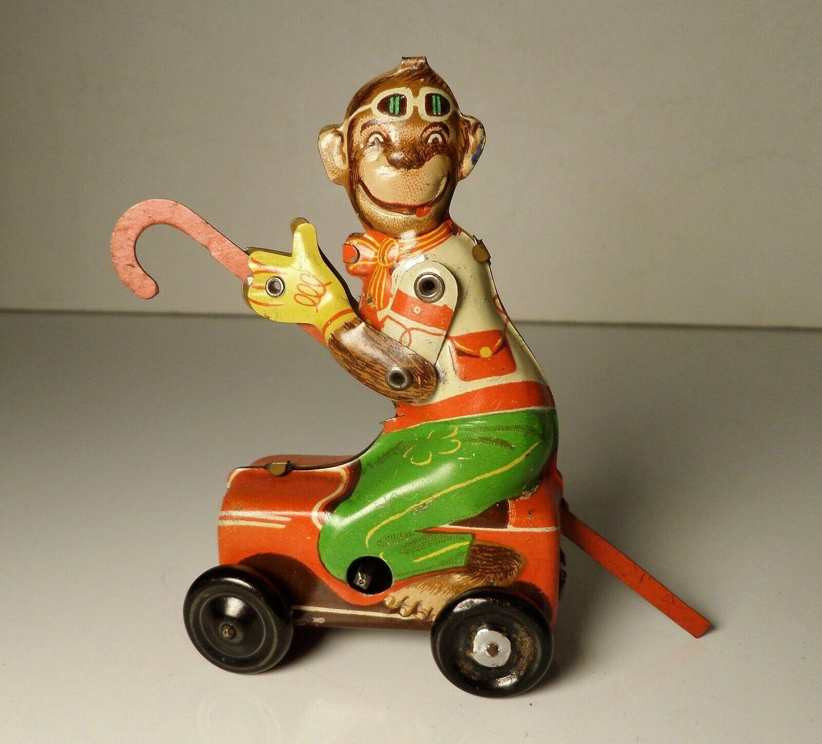 Vintage Tin Toy Windup Litho Monkey on bil w  Cane Penny Toy