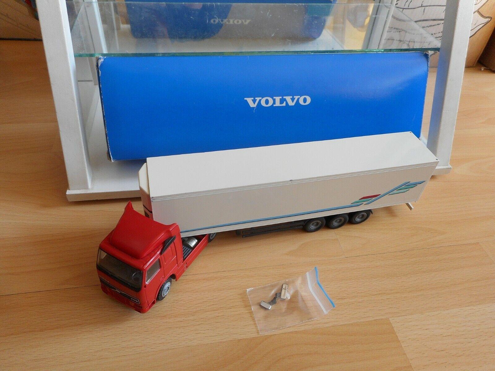 muchas sorpresas Conrad Volvo Volvo Volvo FH12 4x2 + Trailer in rojo blanco on 1 50 in Box  colores increíbles