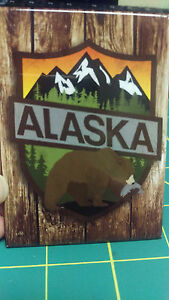 Alaska-Magnet-Bear-with-fish-in-mouth-infront-of-mountain-scene-Made-in-USA