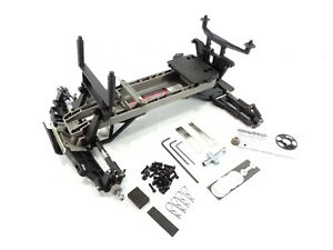 NEW TRAXXAS SLASH 2wd COMPLETE CHASSIS KIT ROLLER ARMS
