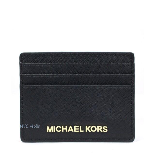 e176e090689211 Michael Kors Jet Set Travel Black Leather Double Zip Wristlet 35f7gtvw9l