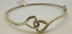 9ct-white-gold-diamond-bangle-with-a-linking-heart-design-and-a-width-of-16-mm