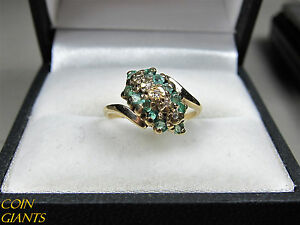 Emerald ring in 10K gold with small diamond accents