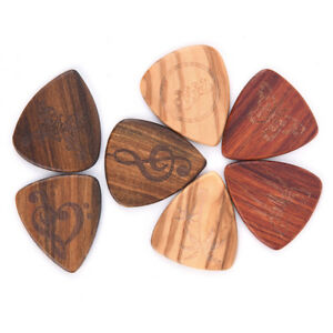 1Pc-Guitar-Picks-Plectrum-Solid-Wood-Finger-picks-Guitarra-Picks-Accessories-BDA