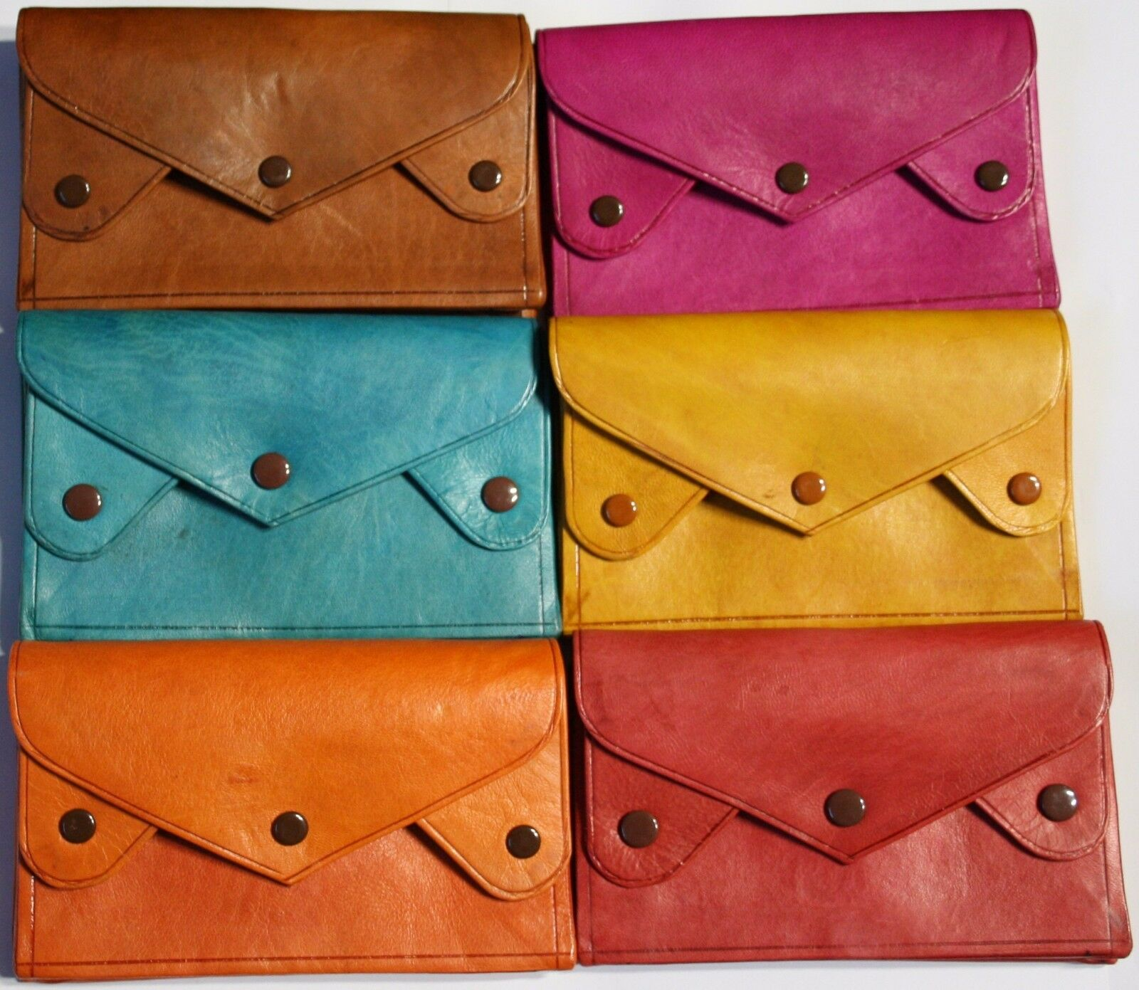 Handmade high quality large coloured leather wallet, with 4 compartments.