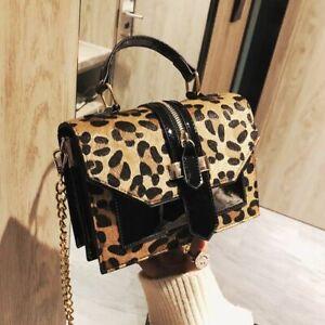 Bolso de piel negro con estampado de leopardo