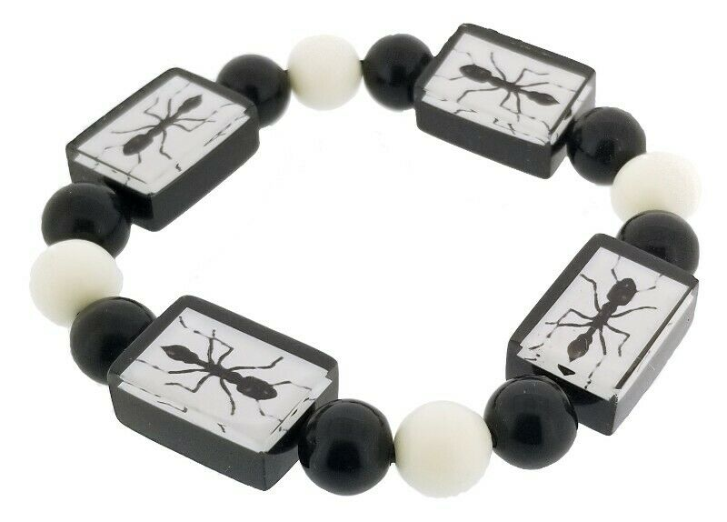 ZSISKA RESIN BRACELET WITH BLACK AND WHITE BEADS WITH ANT DESIGN.