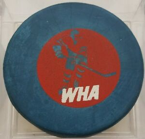 BLUE VINTAGE WORLD HOCKEY ASSOCIATION WHA  OLD GAME PUCK stamped MADE IN CANADA