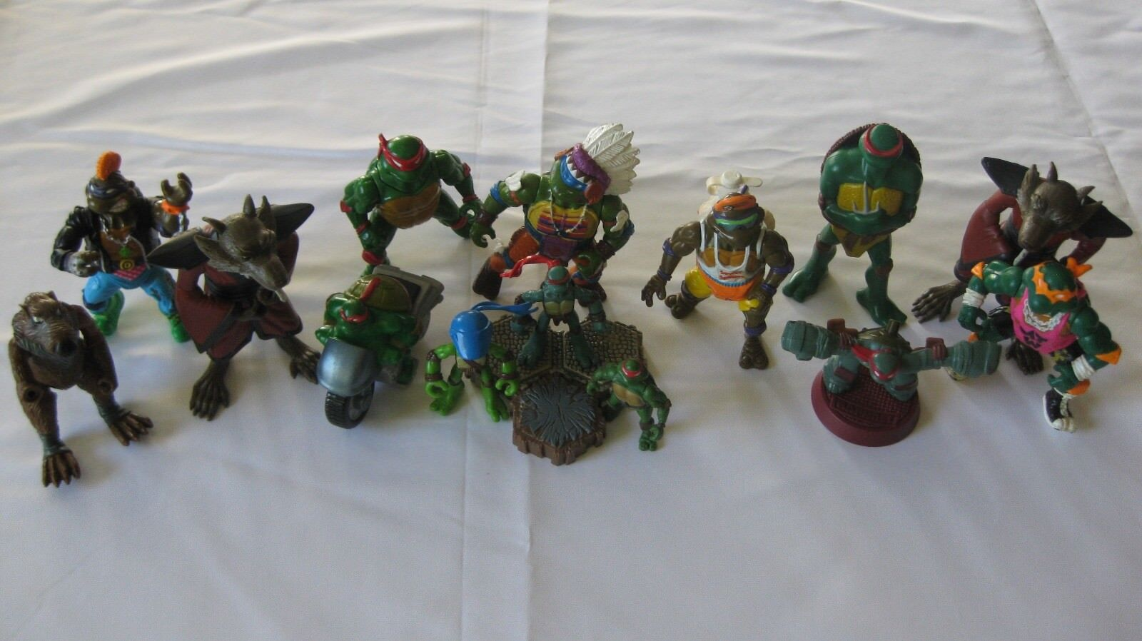 Lot of 14 Vintage Teenage Mutant Ninja Turtles toys various conditions