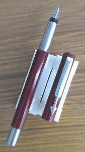 Burgundy-Parker-Vector-good-condition-press-bar-sac-fill-system