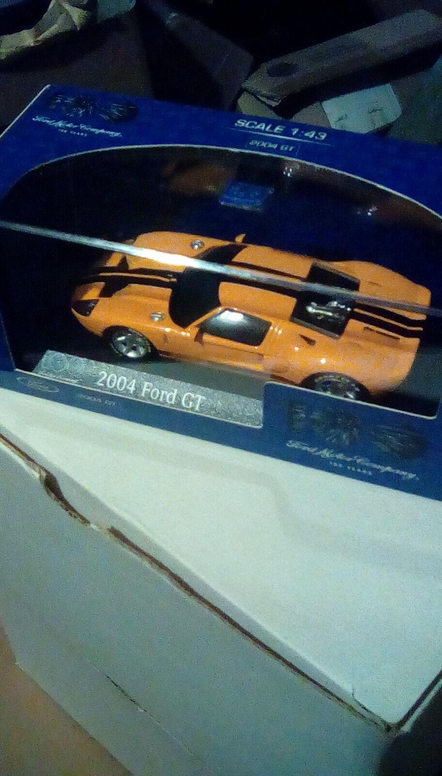 RARE MINICHAMPS FORD GT 100th ANNIVERSARIO Arancione & Nero 1 43 Nuovo di zecca con scatola