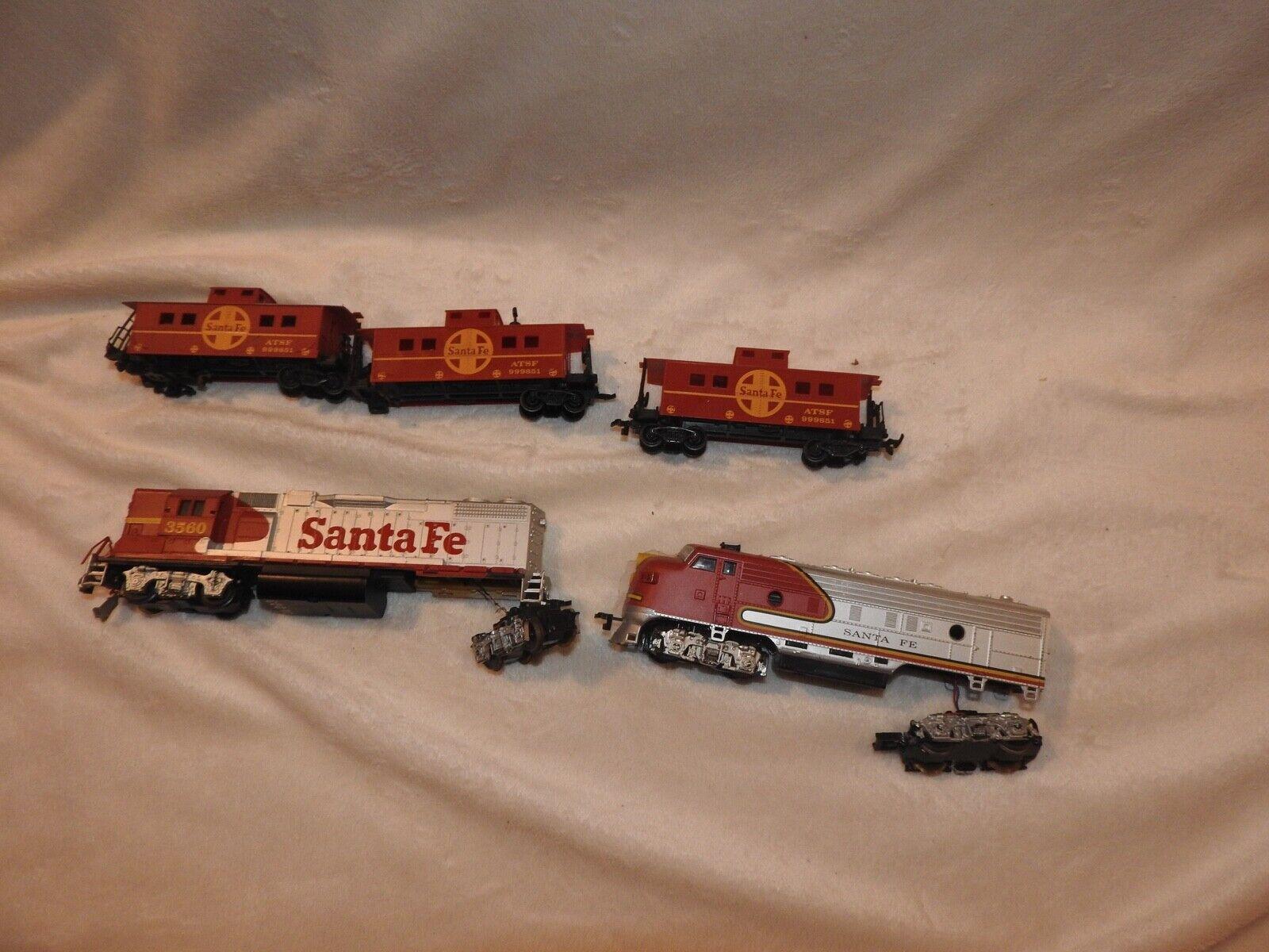 Santa Fe Engines (2)  Caboose (3)  REPAIR PARTS