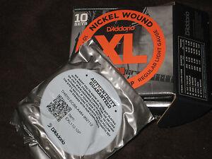1 Set D'addario Exl110 Cordes Pour Guitare électrique, Nickel Wound Regular Light 10-46-afficher Le Titre D'origine Apparence Brillante Et Translucide