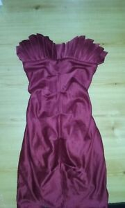 Satin party mini wiggle dress ruching front. Big bow in back.  Womans xs.