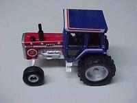 Older 1/64 Massey Ferguson 1155 Spirit of America, Toy Farmer tractor by Ertl,