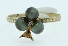 An Unusual Shamrock Cabochon Chrysoberyl Cats Eye & Diamond Ring