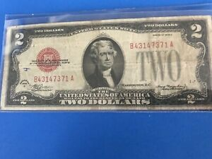 One 1928 C $2 TWO DOLLAR RED SEAL NOTE circulated