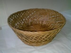 Hand woven vintage round decorative wicker basket made with natural materials