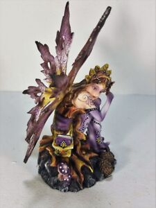 Purple-Fairy-Figurine-Sitting-by-Pine-Cones-Backwoods-Lighting-LLC-91469