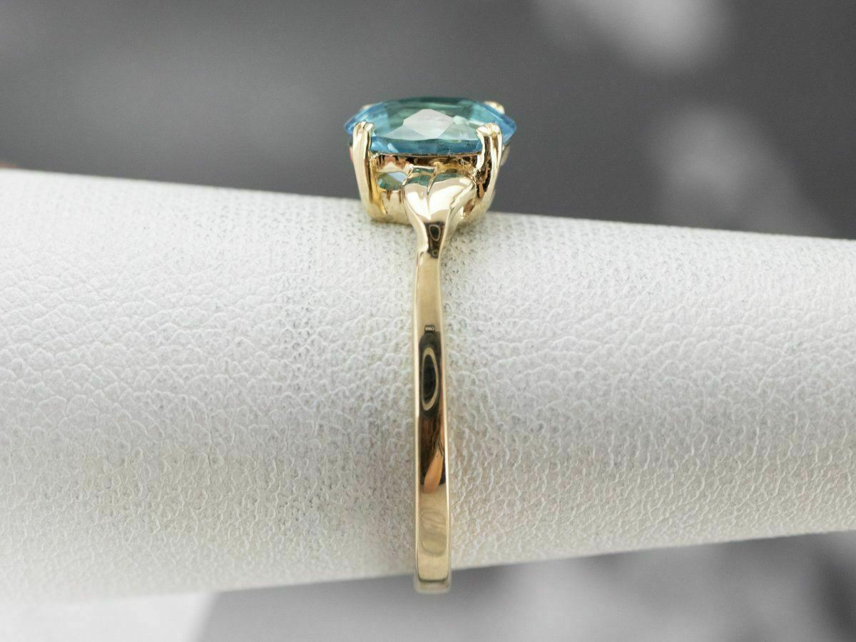 Blue Topaz Gold Solitaire Ring - image 9
