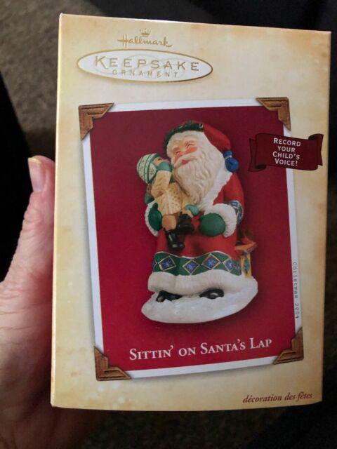 Hallmark keepsake Christmas Ornament Sitting on Santa's ...