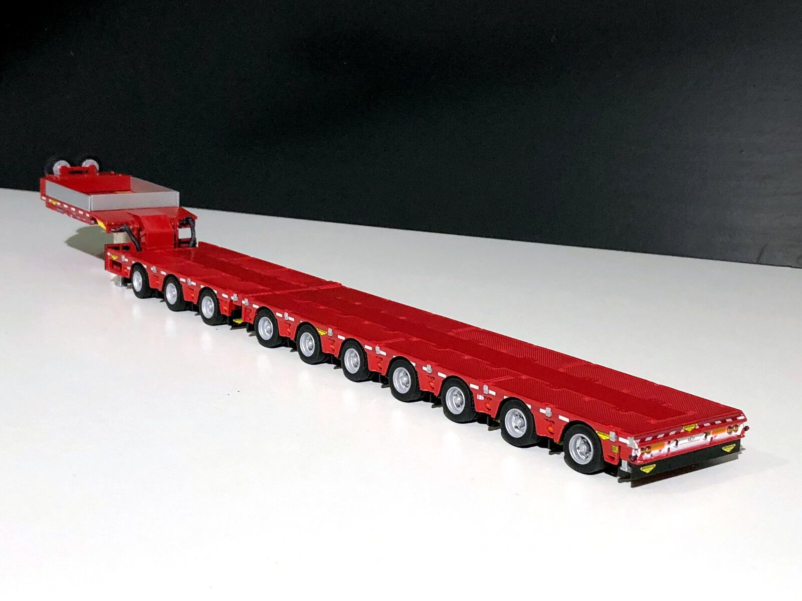 WSI TRUCKS,7 AXLE LOW LOADER(EXTENDIBLE TRAILER)+3 AXLE DOLLY IN RED  BROSHUIS