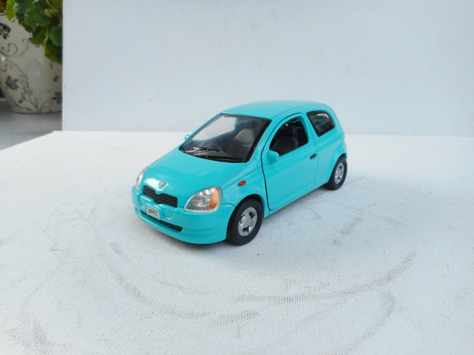 SUNNY SIDE DIECAST VINTAGE 1 25 IN FOREST GREEN FRICTION  TOYOTA YARIS (VITZ