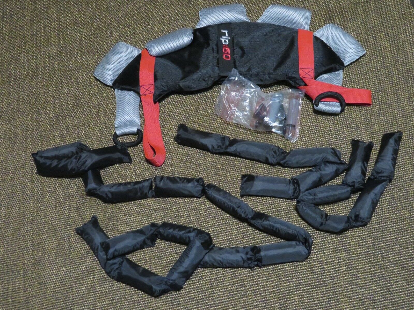 New Rip 60 Padded Power Pack Weight System Adjusts From 5 to 20 Lb.