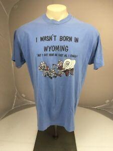 34762a53b2a9 Vintage 1991 I WASN T BORN IN WYOMING blue Travel Souvenir T-shirt ...