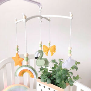 Nursery Bed Bell Rainbow Cribs Rotating Mobile Kids Rattles Baby Cot Toy Decor