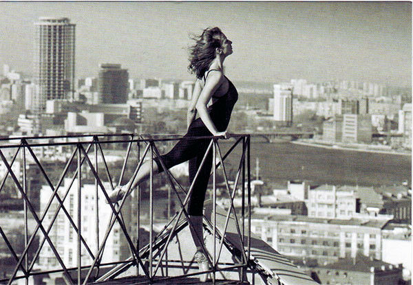 Ballerina on the roof and she is longing to fly Modern Russian postcard