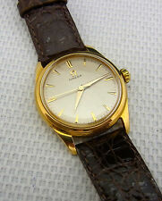 Eine schöne Armbanduhr.  Marke : Omega  750/- Gold cal.420