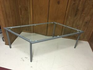 Diamond shaped steel and glass coffee table