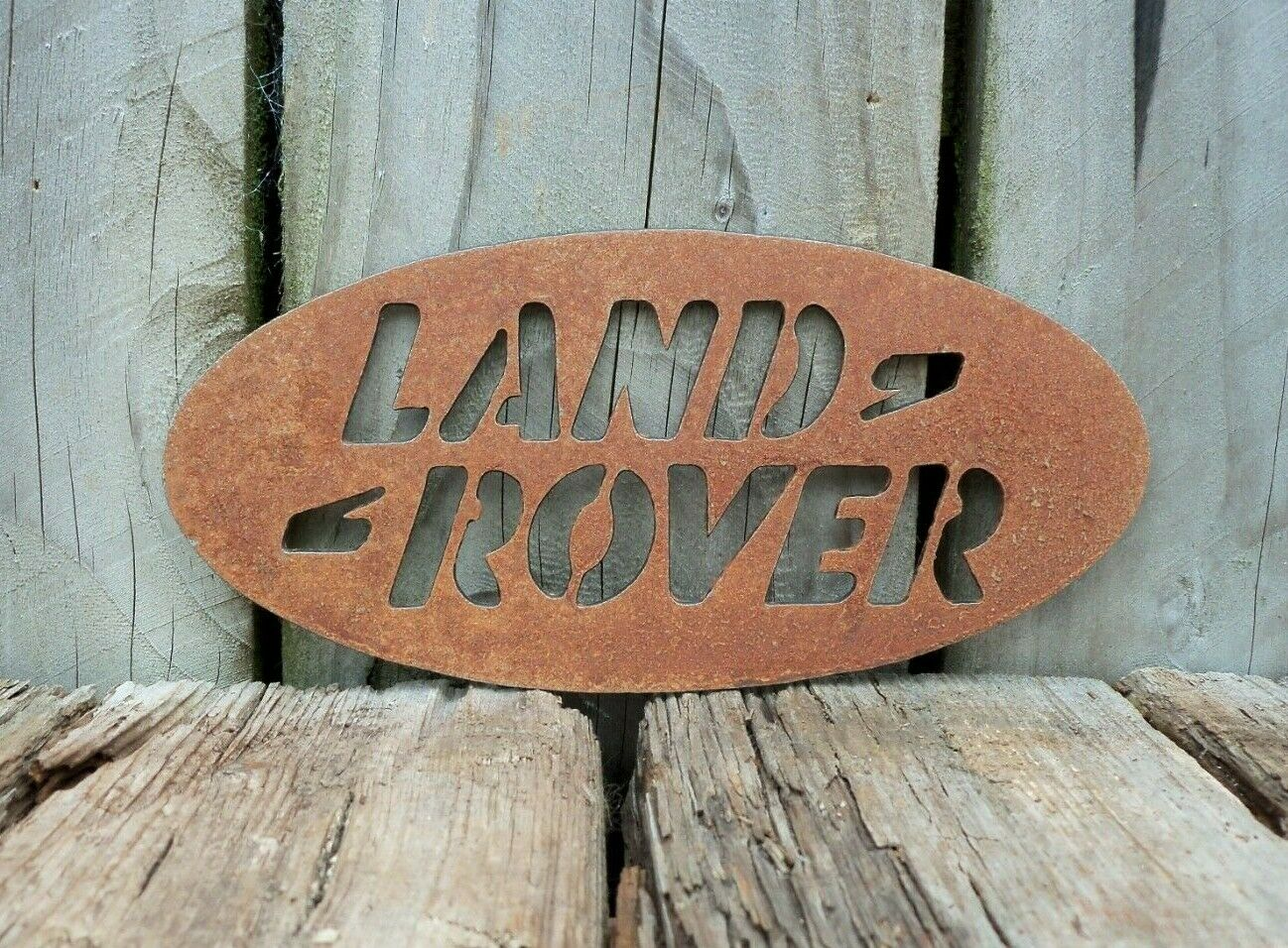 A Rusty Metal LAND ROVER BADGE Sign Garden Ornament Rustic Vintage Gift Birthday