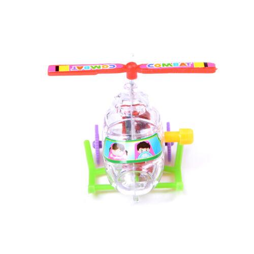 1Pcs Mini Clockwork Transparent Aircraft Somersault Running Wind Up Kids Toy SP