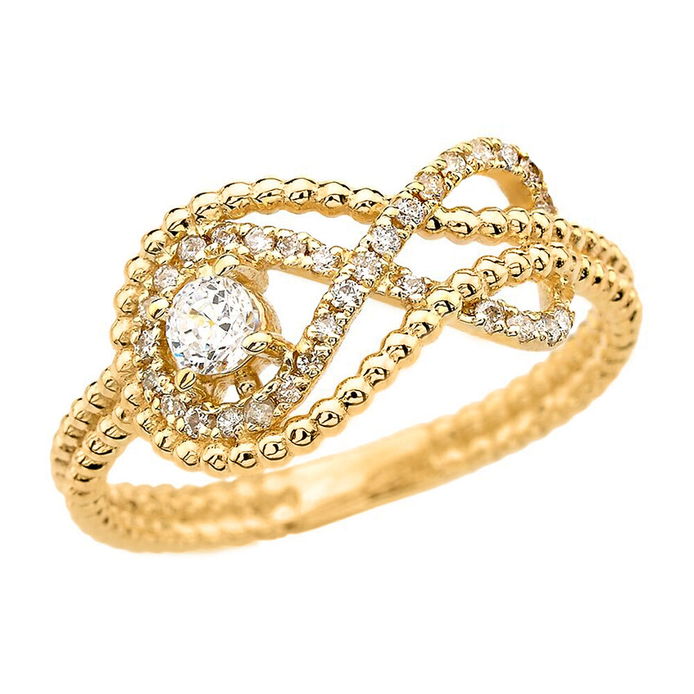 14k Yellow gold Infinity Beaded Ring with a 0.10 ct Diamond & 32 Small Diamonds