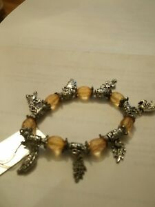 pretty Amber charm bracelet - London, United Kingdom - pretty Amber charm bracelet - London, United Kingdom