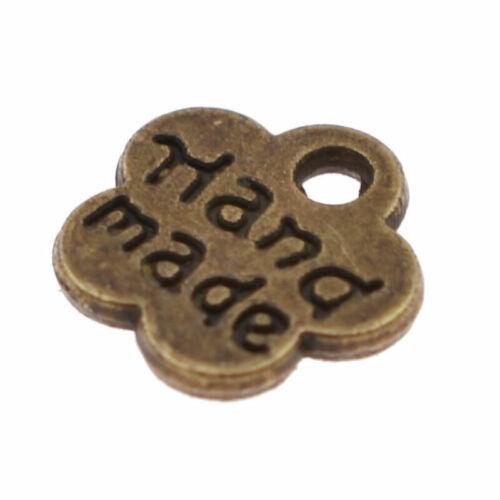Etiquetas de etiquetas de metal de 100 piezas hecho a mano impreso Ropa Costura Artesanía encanto carta